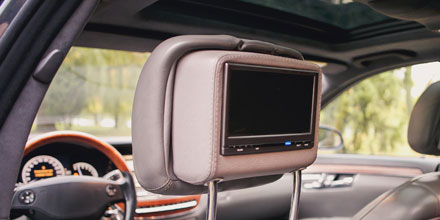 Vehicle-specific Headrest Monitor Programs